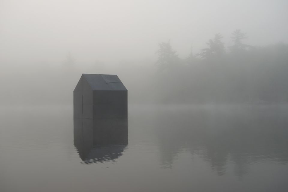 William Lamson's photograph of his reproduction of Thoreau's cabin, which he set afloat.