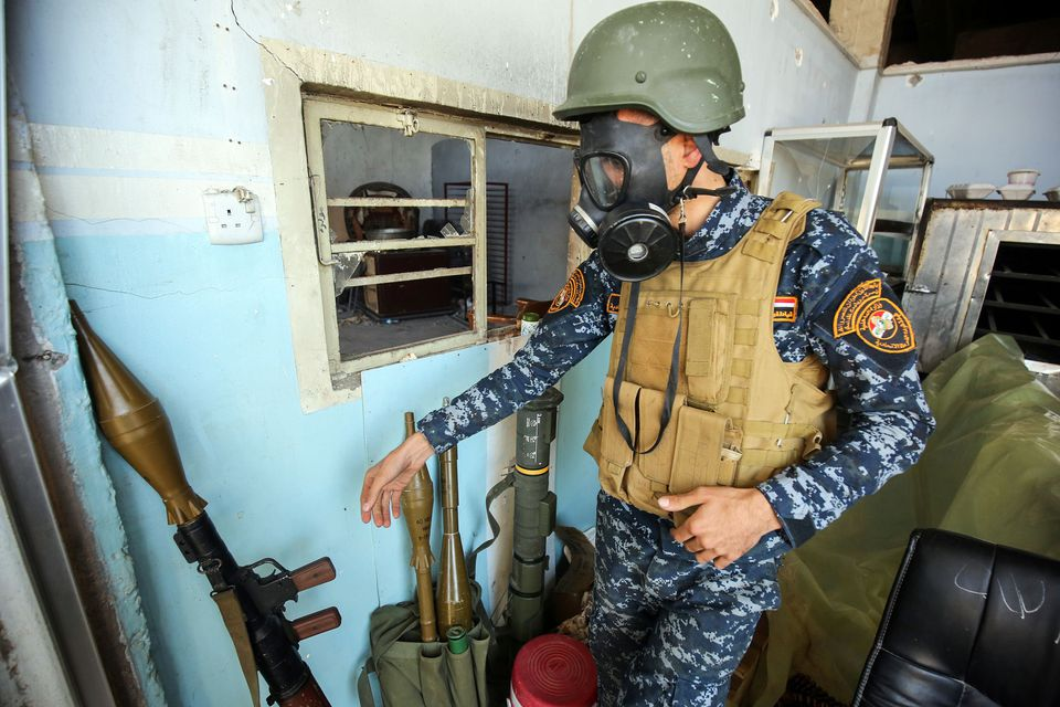 A member of the Iraqi forces wore a gas mask on Sunday during operations to recapture western Mosul from Islamic State fighters.