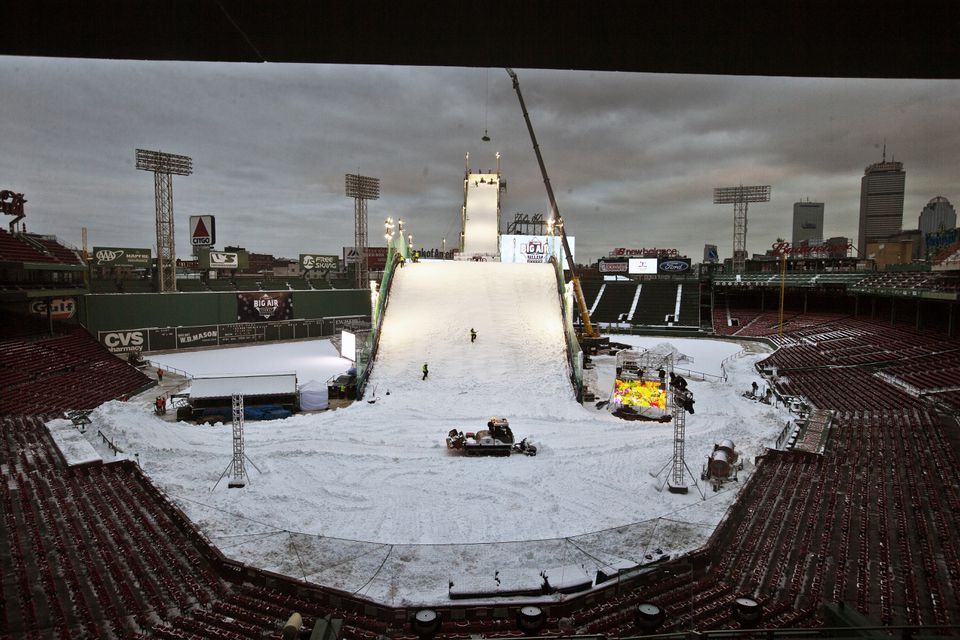 Crews put some finishing touches on the Big Air ramp at Fenway Park at nightfall on Tuesday.