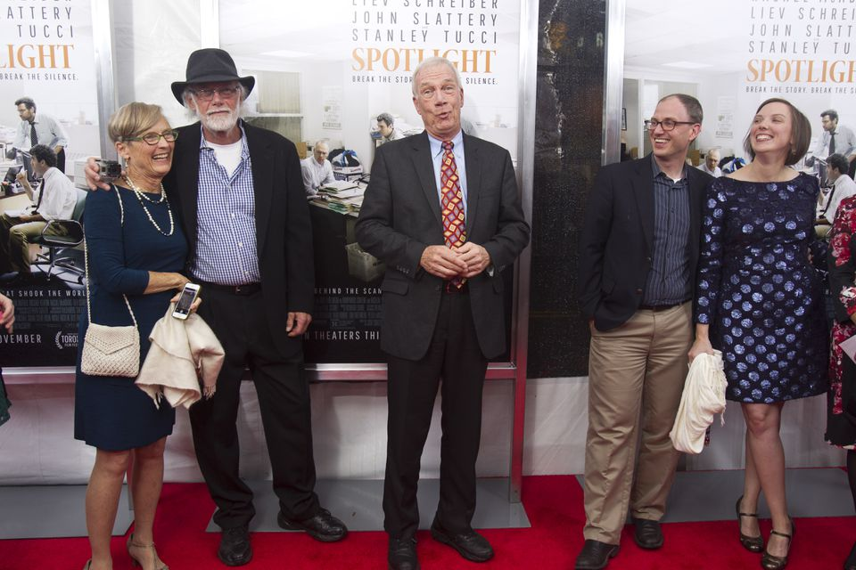 Globe reporter Walter Robinson, center, walked the red carpet during the Boston premiere of Spotlight.