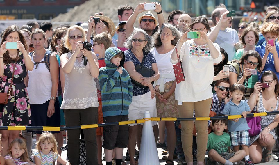 The sculpture was viewed by a crowd Friday.