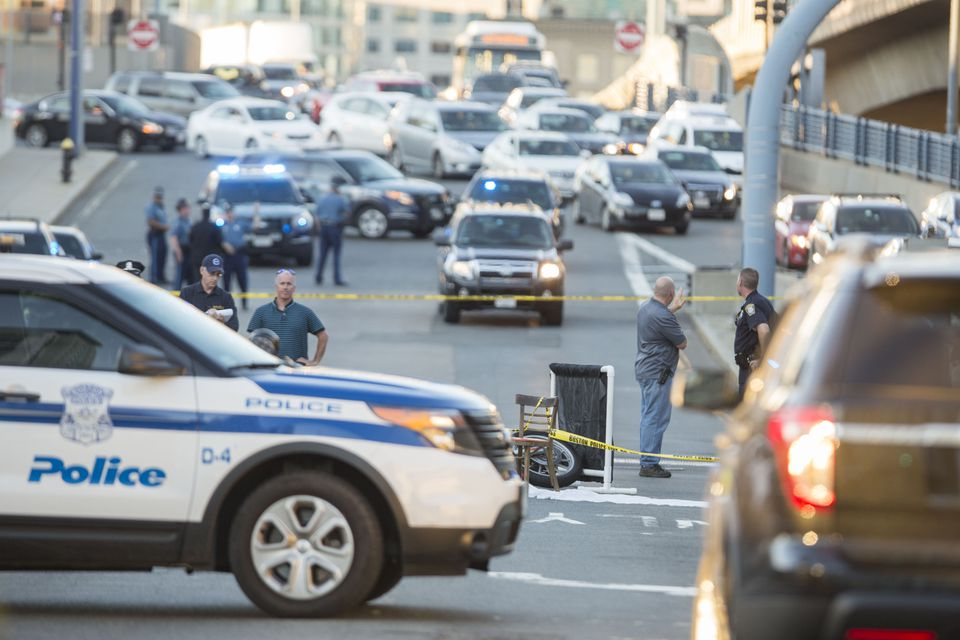 Police officials were at the scene of a fatal motorcycle crash on Albany Street in Boston on Wednesday.