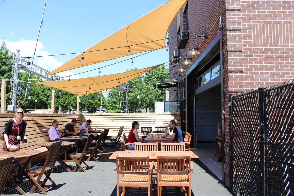 The cafe at Loyal Nine provides an indoor and outdoor space for people to gather, work on their laptops, and socialize.