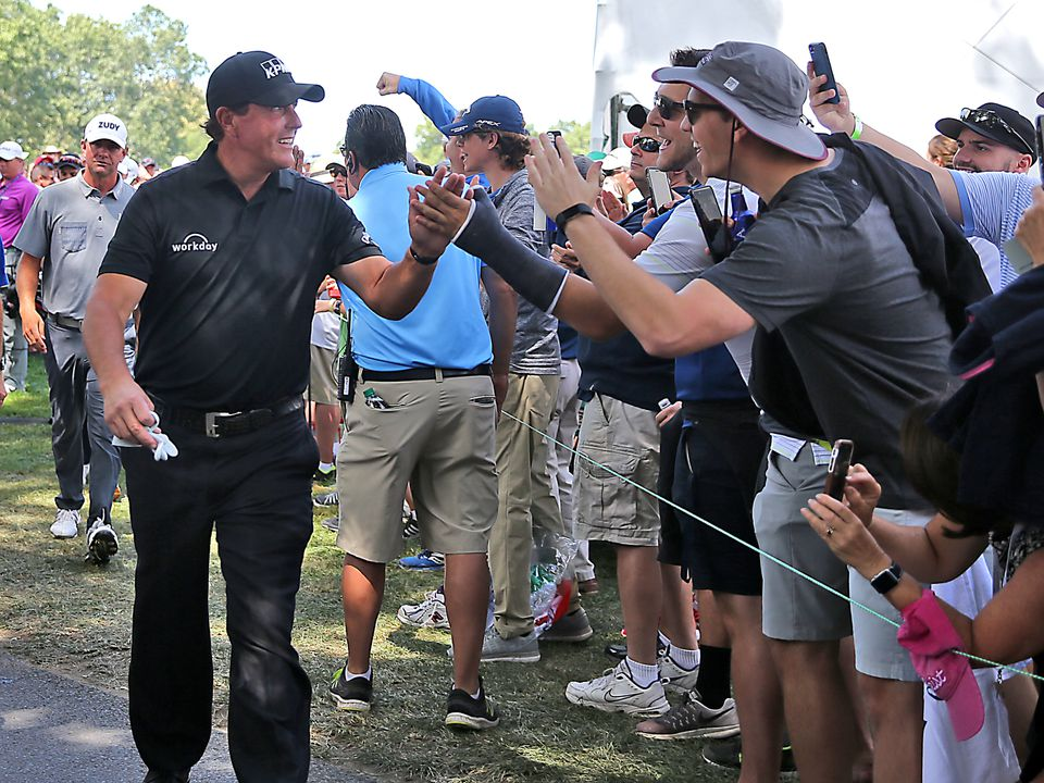 Phil Mickelson high-fived fans as he walked off the 16th green during the second round of the Dell Technologies Championship at the TPC Boston in 2017.