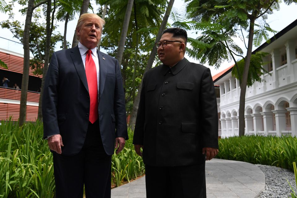 President Trump and Kim Jong Un went for a stroll during a break in their talks.
