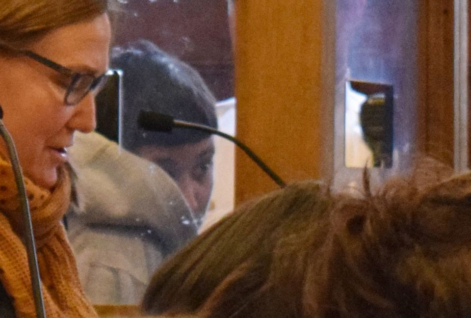 Graciela Paulino of Lowell appeared Friday morning in Lowell District Court wearing a hooded sweatshirt and stood hunched over, trying to hide her face, during her arraignment.
