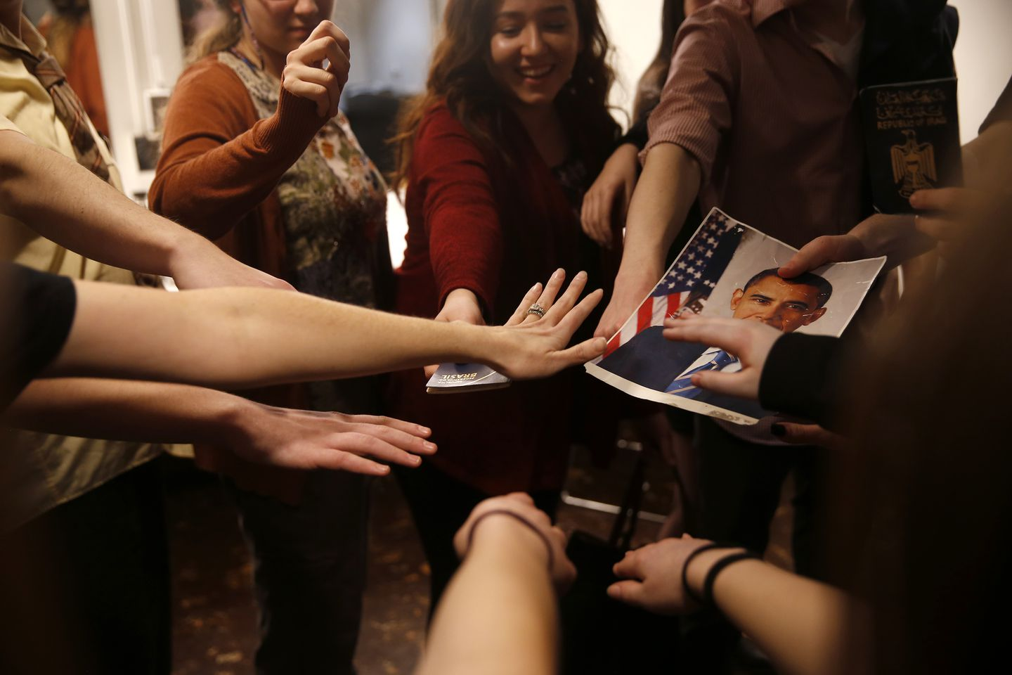As the actors gathered into a tight circle before their final performance, Deb thrust out her hand with her Brazilian passport in it.