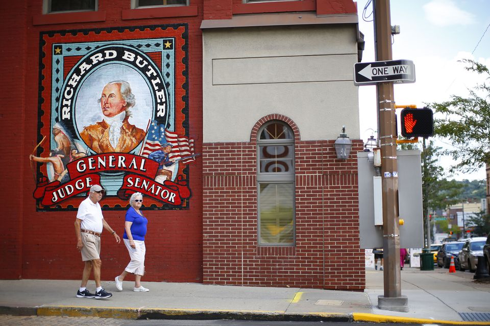A couple walked past a newly commissioned mural in downtown Butler.