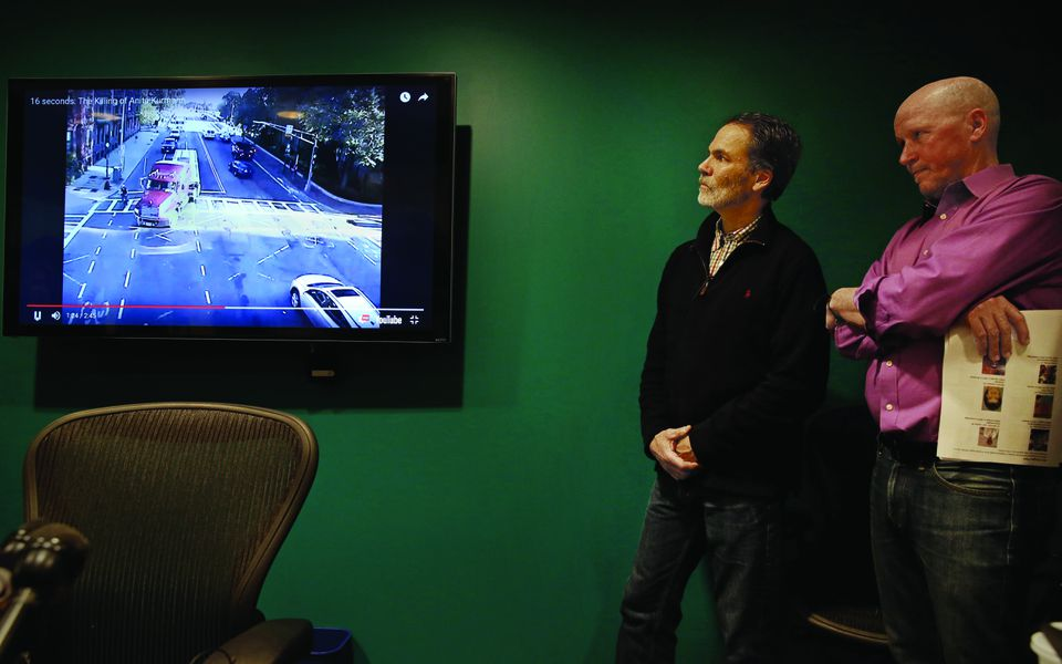 Alan Wright (left), of RozzieBikes, and Richard Fries, executive director of MassBike, used video footage of the fatal accident to help make their case that police should have charged the truck driver.