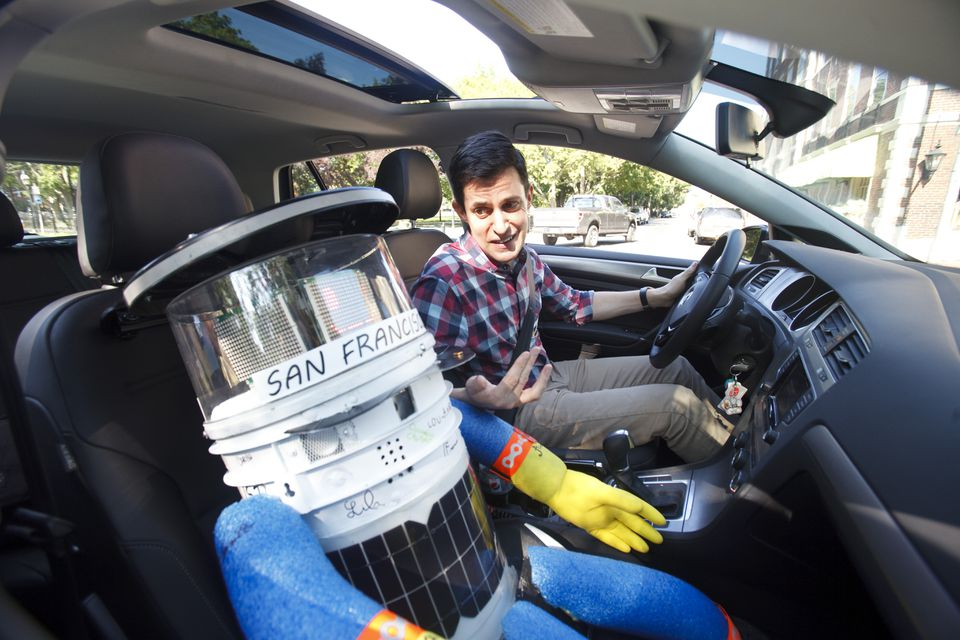 The author gives hitchBOT a ride around the block.