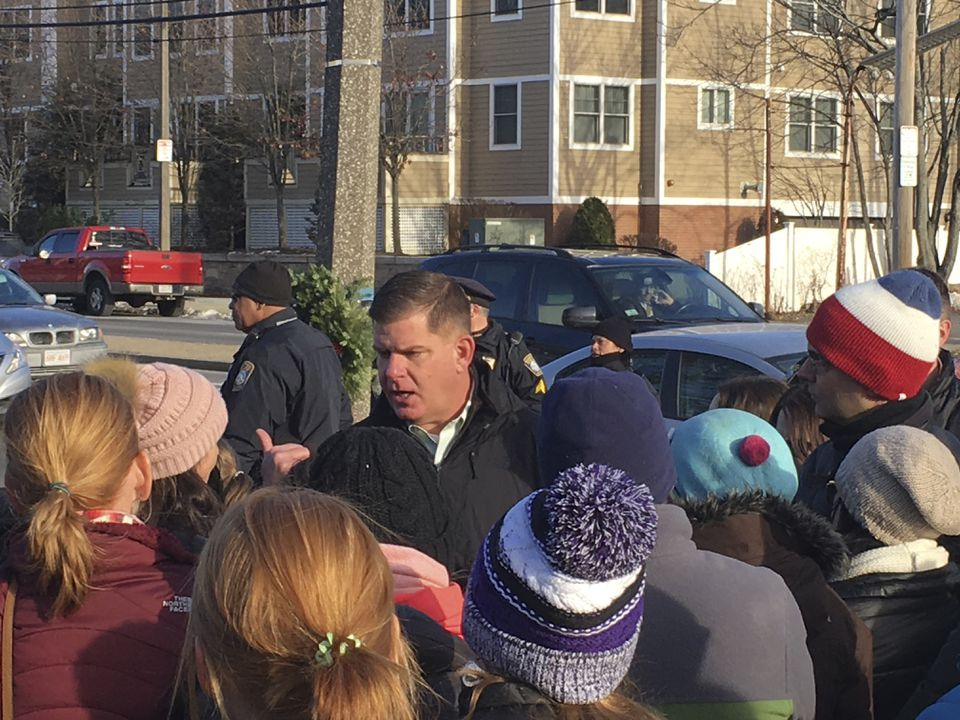 Angry parents confronted Mayor Martin J. Walsh at a Christmas tree lighting ceremony in West Roxbury on Sunday. The parents are angry over earlier start times planned for dozens of Boston's schools.