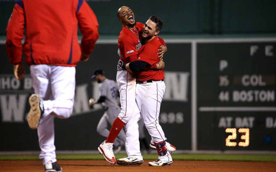 Mookie Betts (left) celebrates with Michael Chavis after the rookie's game-winning hit Wednesday.
