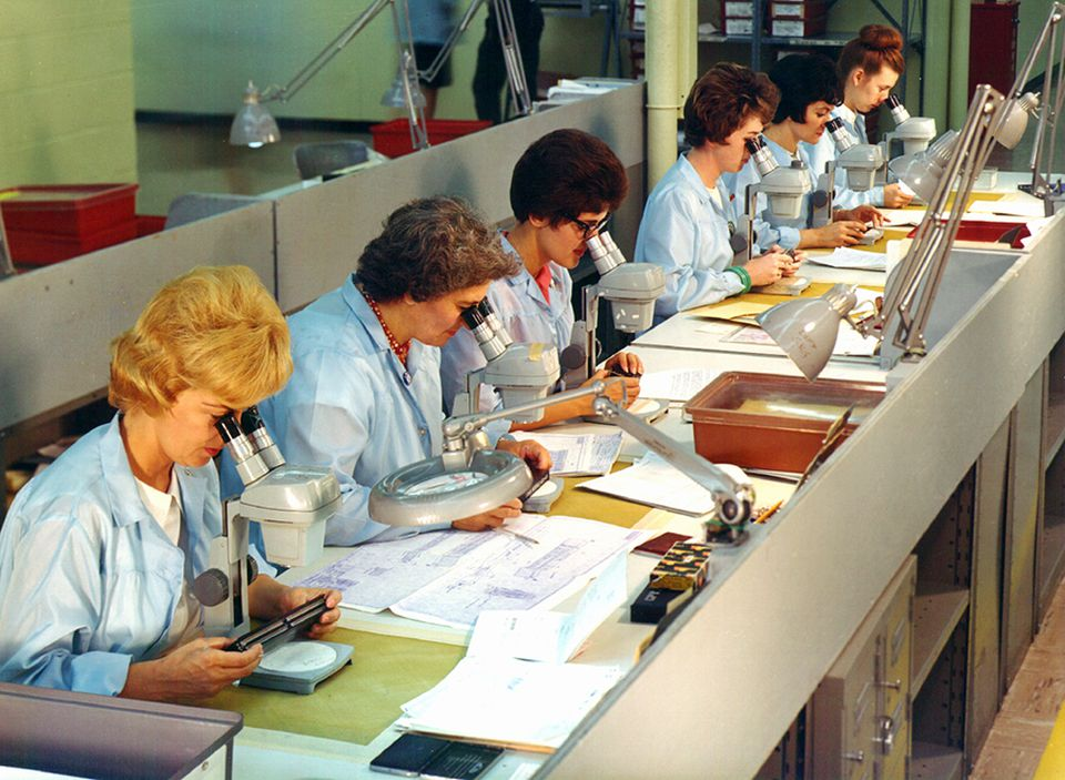 Raytheon workers stitched copper wire into the memory circuits of the Apollo spacecraft computer.