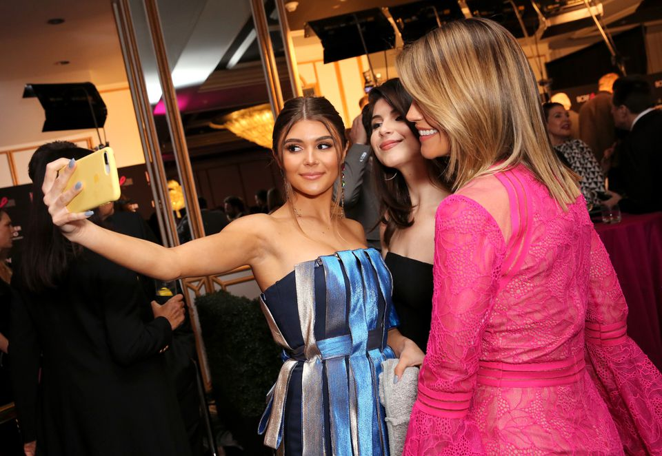 Olivia Jade Giannulli (left) with her sister, Isabella Rose Giannulli (center), and mom, Lori Loughlin, in February.