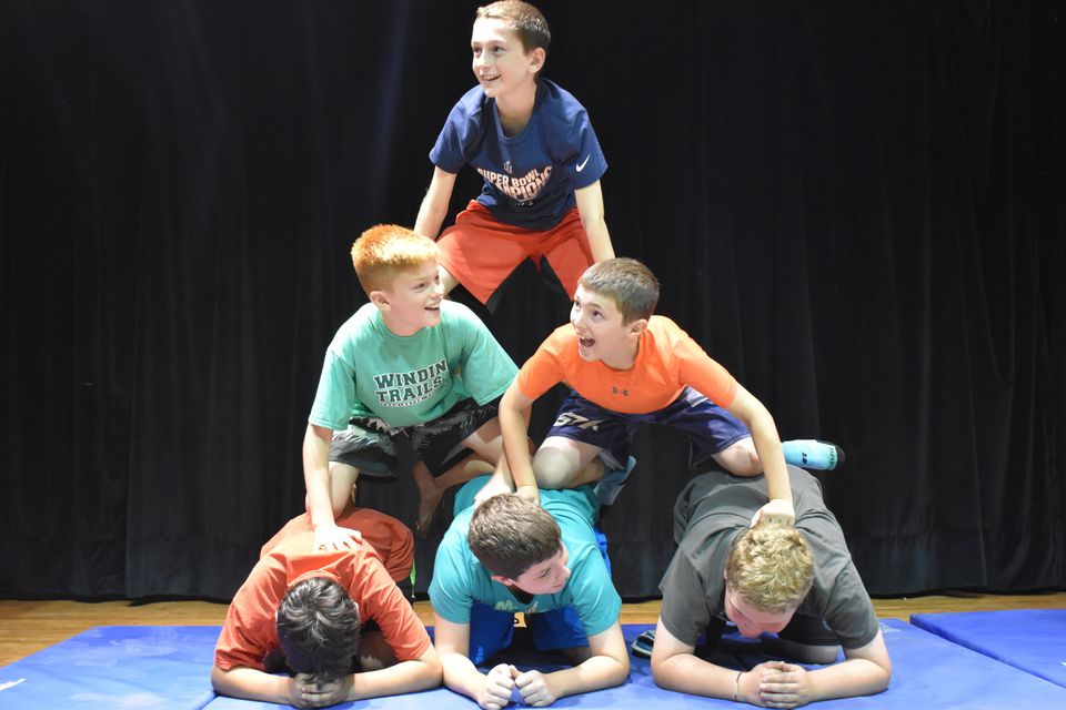 Campers collaborate to build a human pyramid at Camp Young Judaea.
