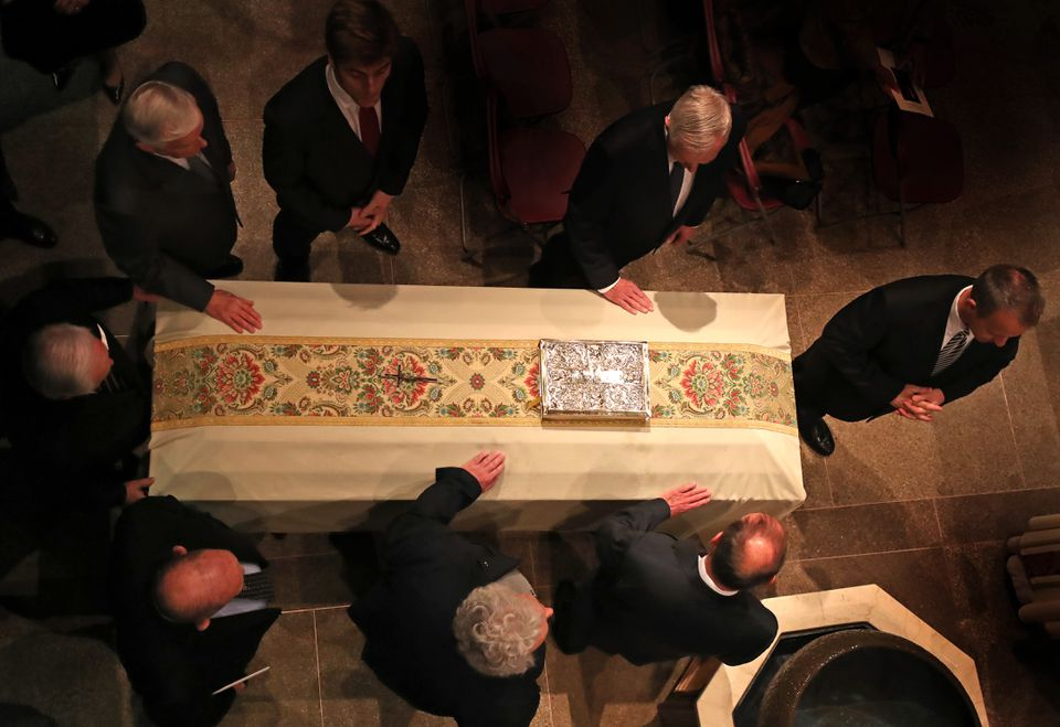 The casket of Rev. J. Donald Monan, the leader of Boston College for a quarter century, was placed in an aisle at St. Ignatius Church Wednesday.