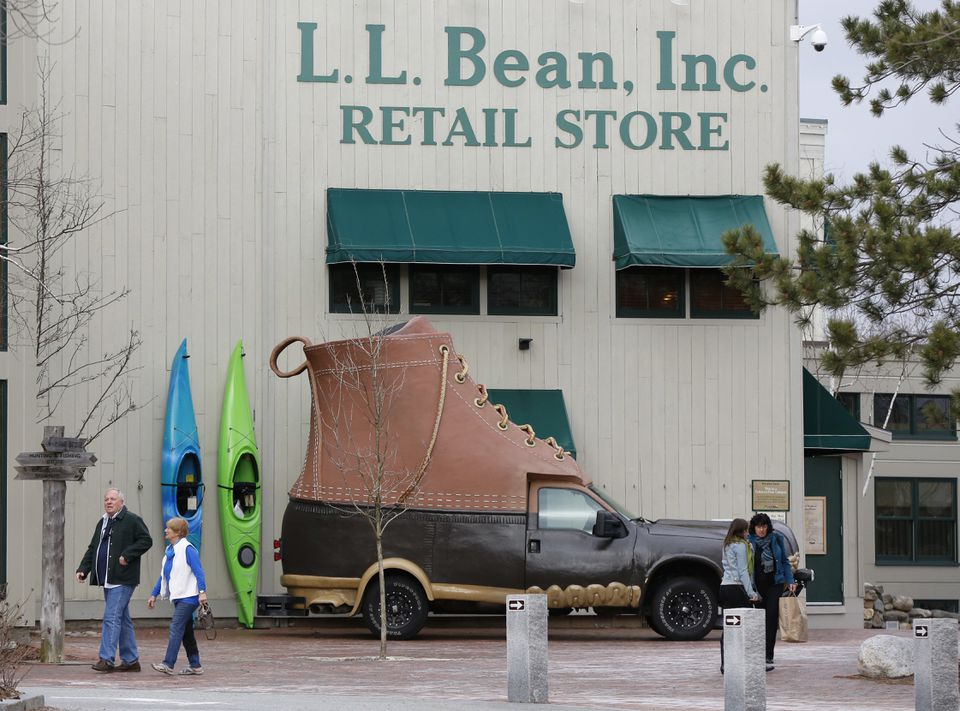Shoppers walk outside the L.L. Bean retail store in Freeport, Maine, in March 2016.