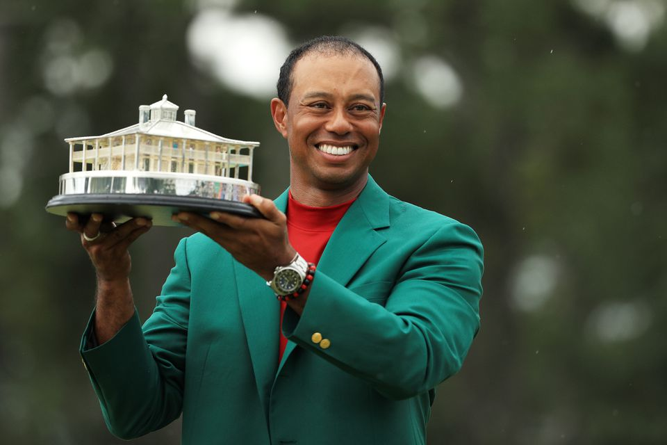 Tiger Woods displays the Masters Trophy following his victory Sunday.