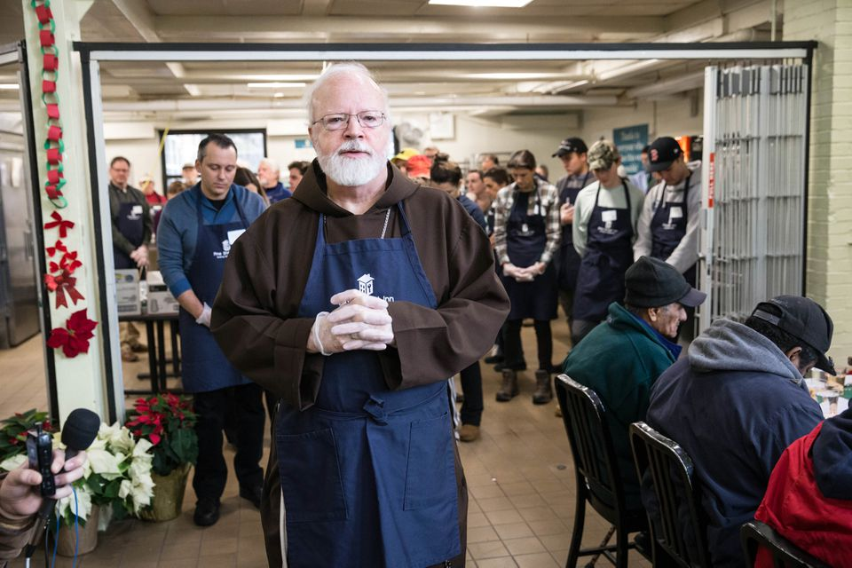 Cardinal Sean O'Malley offered a blessing at Pine Street Inn in Boston on Christmas Eve.