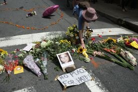 A woman placed flowers at a memorial to 32-year-old Heather Heyer, who was killed Saturday.