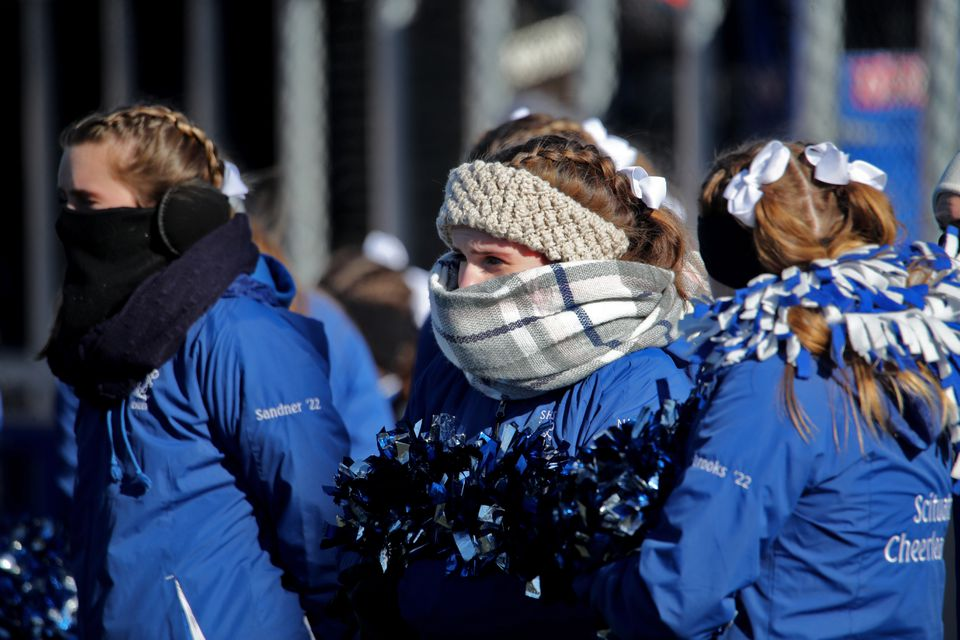 Scituate High cheerleaders felt the temperature in the game against Hingham High.