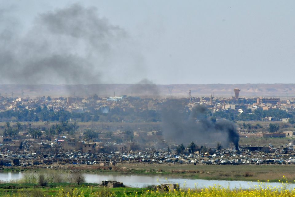 Smoke rises from the last remaining ISIS militant's position in the village of Baghouz, on Wednesday.