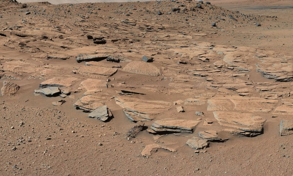 Beds of sandstone inclined to the southwest toward Mount Sharp and away from the Gale Crater rim.