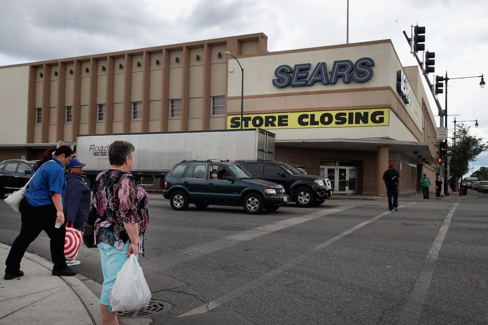 b9012598066 A sign announced that a Chicago Sears store was closing.