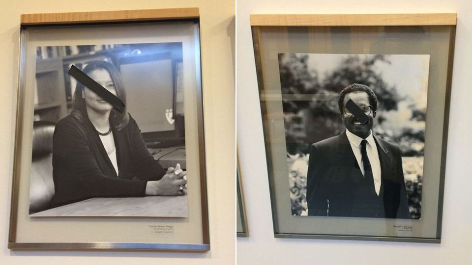 Harvard police are investigating after students at the law school discovered someone put strips of black tape over images of black professors.