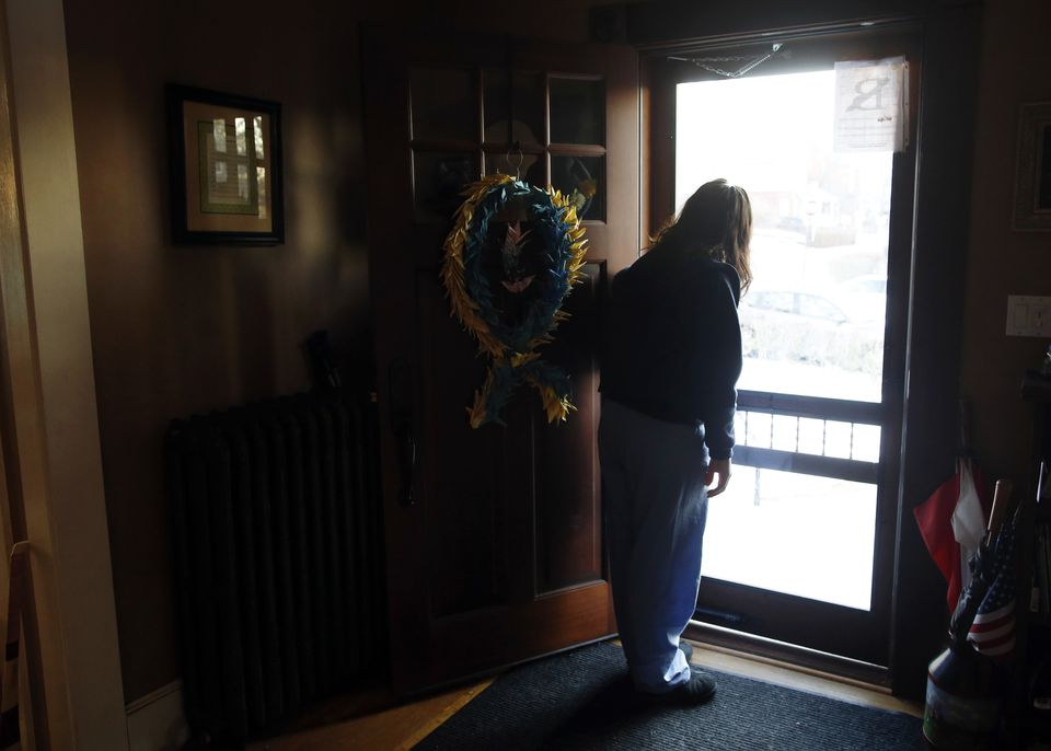 DEVASTATED BY THE ATTACK: Denise Richard lingered in the doorway as her son Henry headed off to school. The Richards have struggled with the death of Martin and their own injuries over the past year.