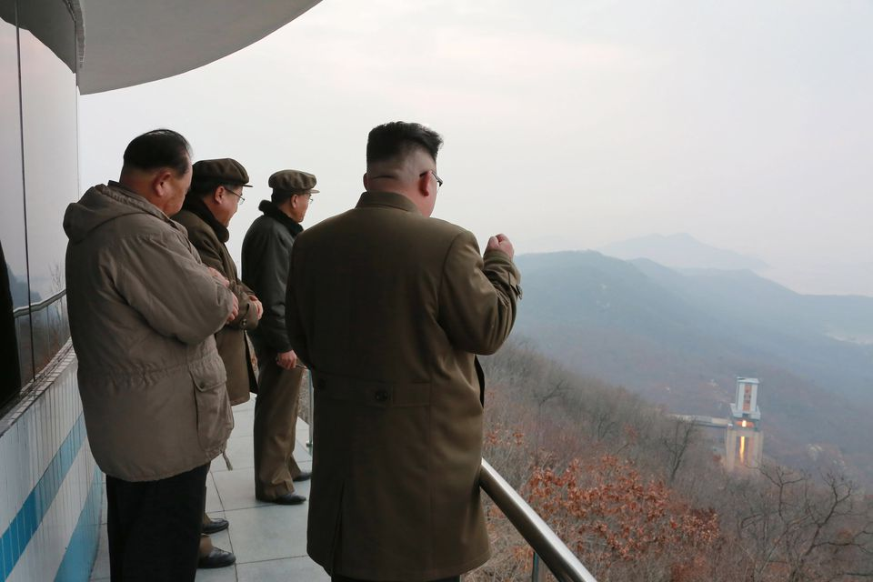 A photo released by the North Korean Central News Agency shows North Korean leader Kim Jong Un, at right, watching the ground jet test of a high-thrust engine at an undisclosed location in North Korea on March 19.