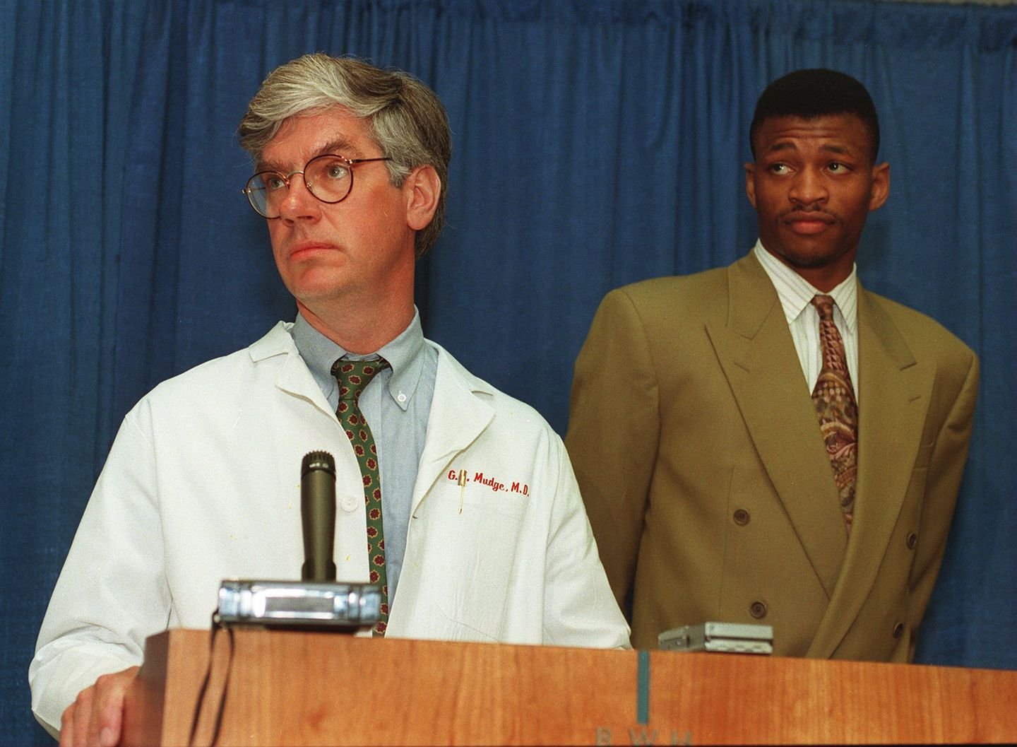 In 1993, Dr. Gilbert Mudge and Celtics player Reggie Lewis held a news conference to discuss his diagnosis.
