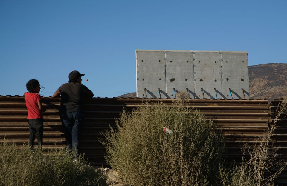 People watched prototype sections of a border wall between Mexico and the United States under construction in Tijuana, Mexico.