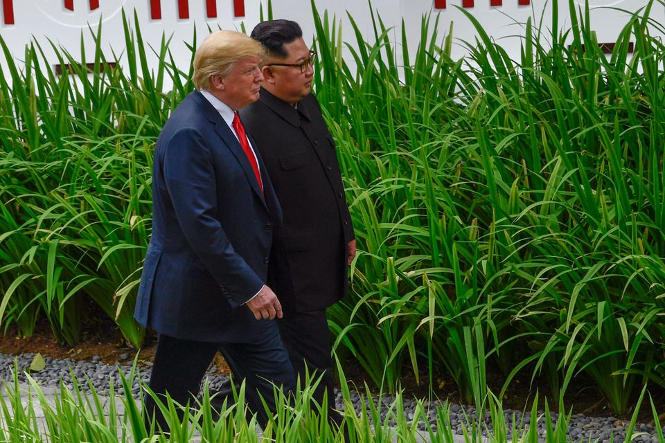 Kim and Trump walked after their working lunch.
