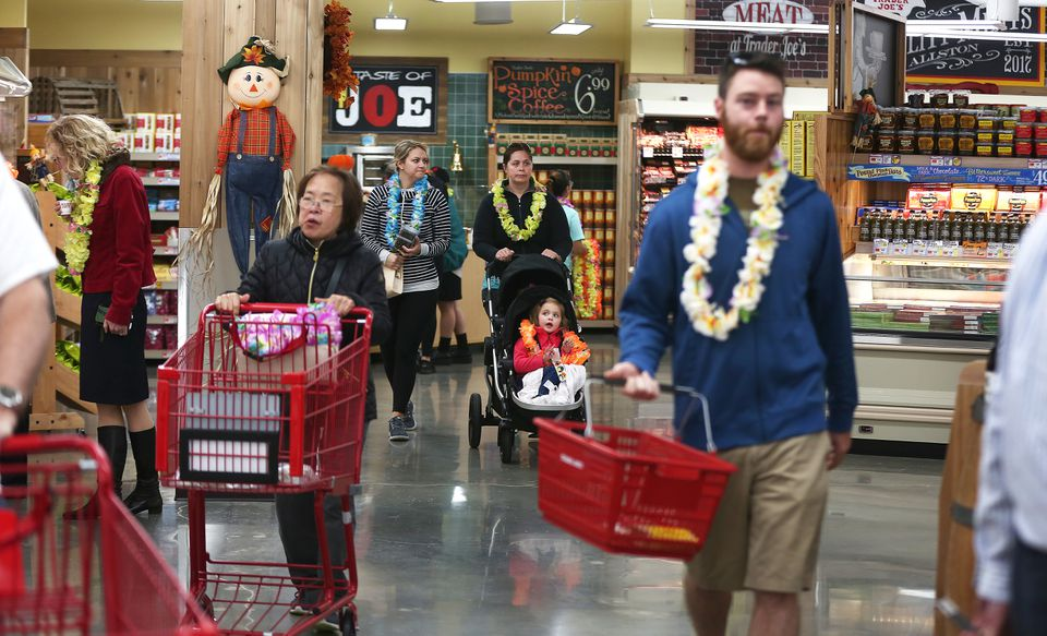 Opening-day customers at the Trader Joe's in Allston got leis to wear.