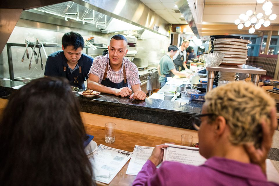 Sous chef Yesid Areiza spoke with customers from the open kitchen at Whaling in Oklahoma in the South End.