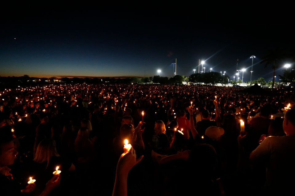 Mourners attended a candlelight vigil for victims of Marjory Stoneman Douglas High School shooting in Parkland, Florida on Thursday.