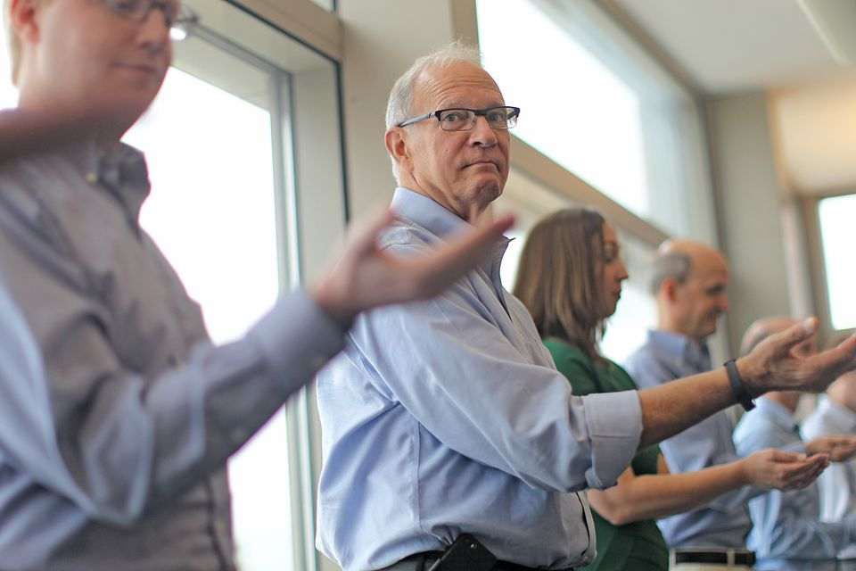 The arm-stretching, improvisational exercises are intended to make BU scientists vulnerable and open to other people.