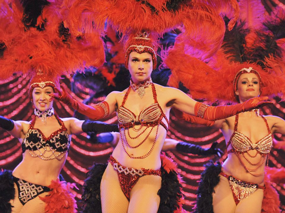 Sutton Foster (center) plays a showgirl whose dreams of Broadway have been dashed.
