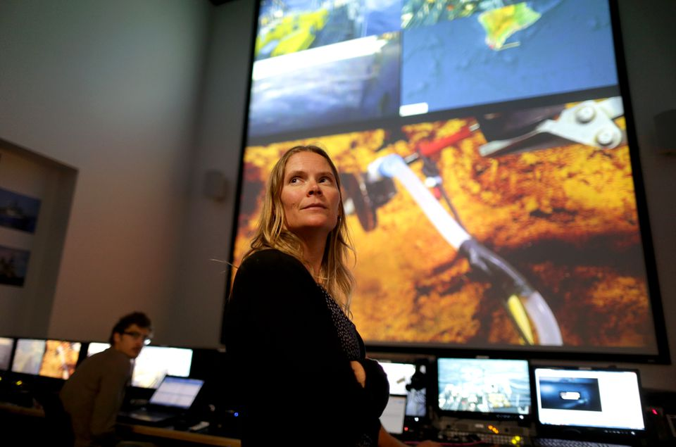 Julie Huber, an associate scientist in marine chemistry and geochemistry at Woods Hole Oceanographic Institution, inside the Inner Space Center Mission Control area at the University of Rhode Island in Narragansett. NASA is preparing for future space missions by exploring underwater volcanoes off Hawaii.
