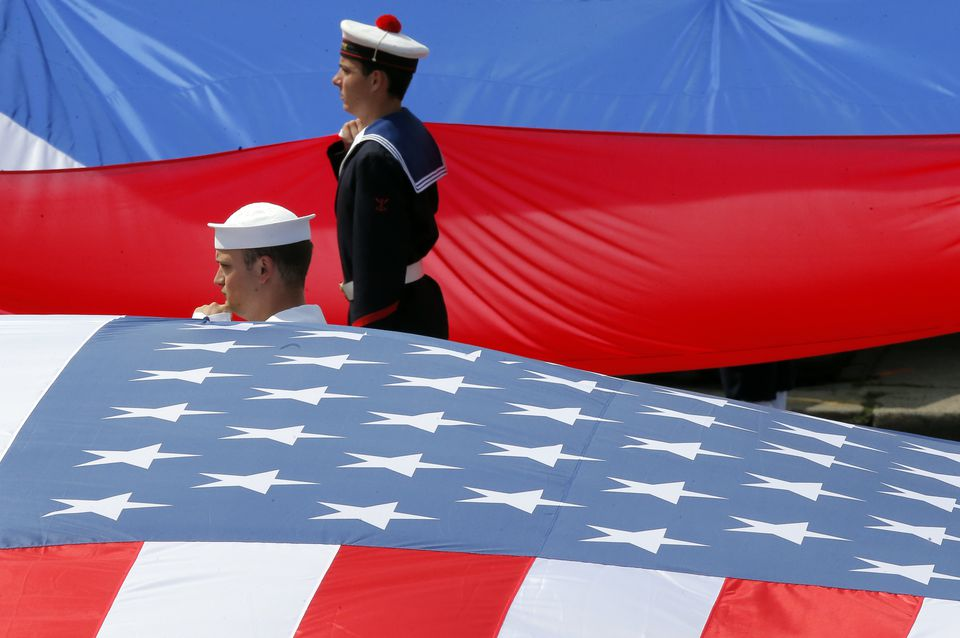 French and US soldiers displayed their national flags at the end the traditional Bastille Day military parade.