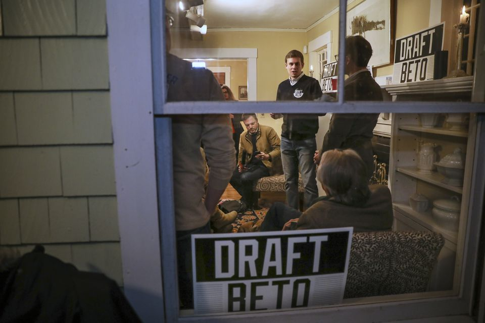 Viewed from the front porch, Draft Beto co-chair Will Herberich (center) spoke at a house party for the Draft Beto movement in Concord, N.H., on Wednesday.
