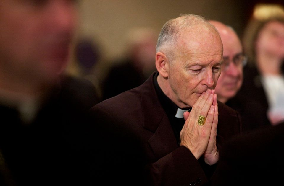 Then-Cardinal Theodore McCarrick prays at the US Conference of Catholic Bishops in 2002.