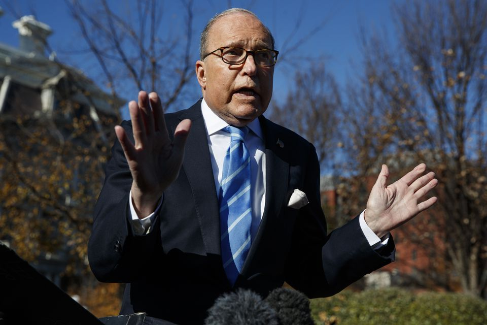 White House chief economic adviser Larry Kudlow (above) says US consumers would bear a burden from the escalating trade war with China, contradicting his boss — President Trump.