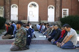 Men prayed during Sunday's event. Thousands flocked to the Malden festival, including several area politicians.
