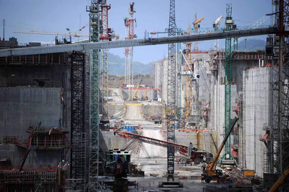 Work is underway (top) to expand the Panama Canal.