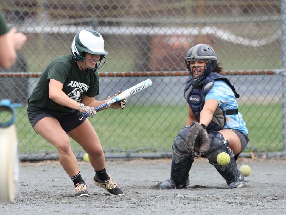 Abington's Lauren Keleher works on slapping a bunt down the third-base line at practice.