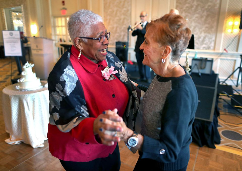 Marchelle Raynor of Roxbury (left) said her husband of 51 years, James, liked to talk more than dance. She asked Mary Ann Longo of the North End to dance. Longo is married for 52 years to her husband, Richard. The two never met before until the annual Golden Wedding Anniversary Celebration. Their husbands sat at a table and chatted while the pair danced.