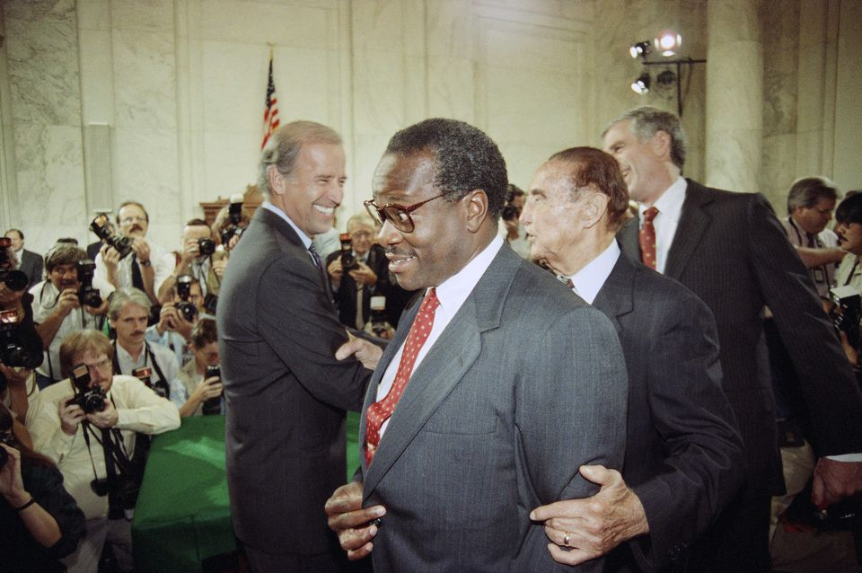 Supreme Court Justice nominee Clarence Thomas is escorted by Senator Strom Thurmond, second from right, and Senator John Danforth, right, while walking past Senator Joe Biden, the Senate Judiciary Committee Chairman, Sept. 10, 1991, prior to the start of Thomas's nomination hearing.