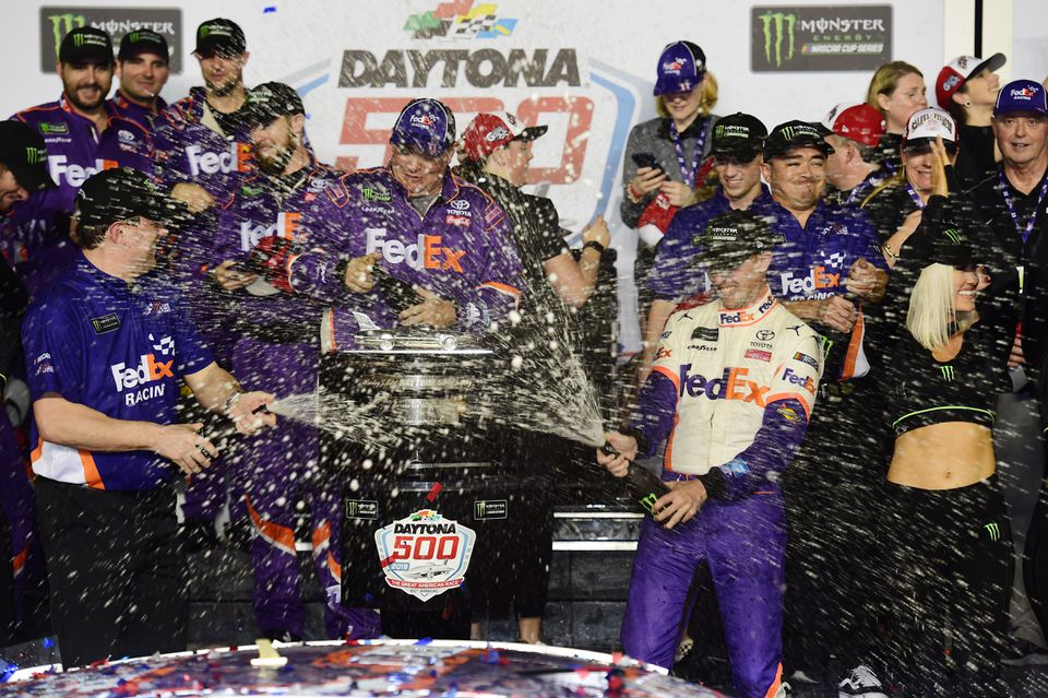 Denny Hamlin, driver of the  No. 11 FedEx Toyota, celebrates his second career victory in the Daytona 500 in Victory Lane on Sunday at Daytona International Speedway.